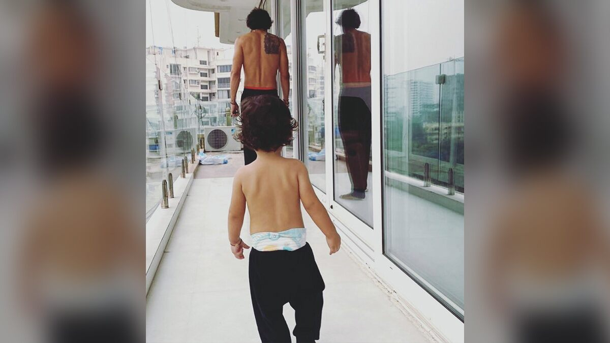 Arjun Rampal Shares Adorable Pic Twinning With Son Arik in the Balcony (See Pic)
